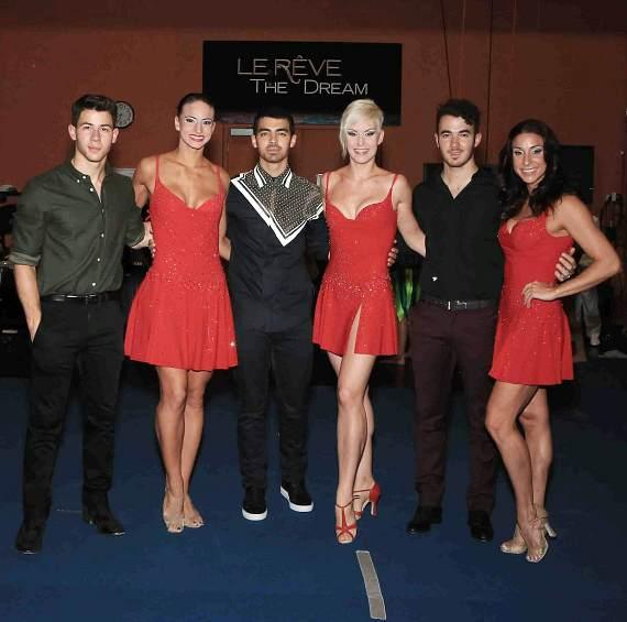 Jonas Brothers with cast members of Le Reve