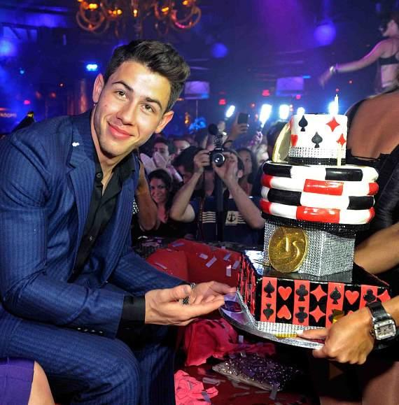 Nick Jonas with birthday cake at XS