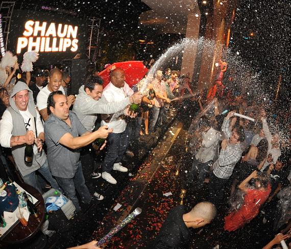 Shaun Phillips with champagne