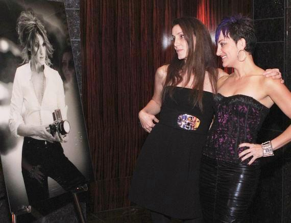 Denise Truscello and guest view a photo of Celine Dion