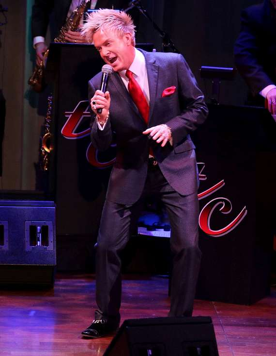 "Chris Phillips (Zowie Bowie) performs in ""Christmas at My Place"""