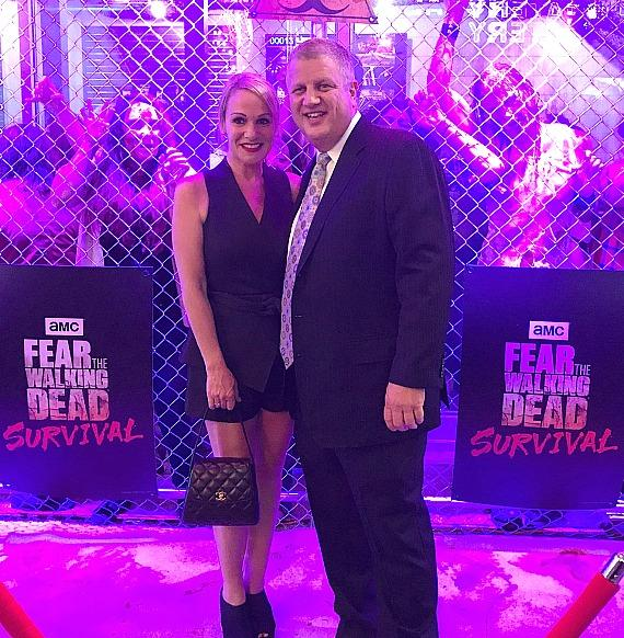 "Casino Owner Derek Stevens with wife Nicole Parthum at ""Fear The Walking Dead: Survival"" attraction on Fremont Street Experience Las Vegas"