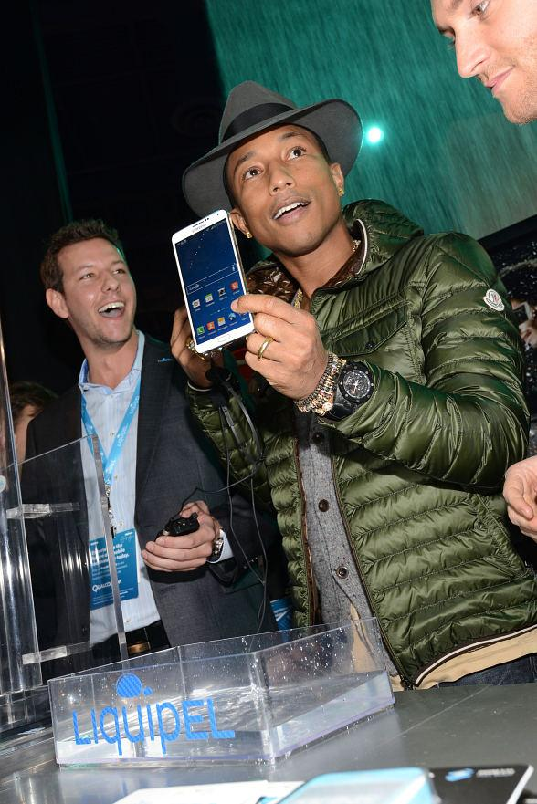 Pharrell Williams Appears in Liquipel Booth at 2014 Int'l CES in Las Vegas