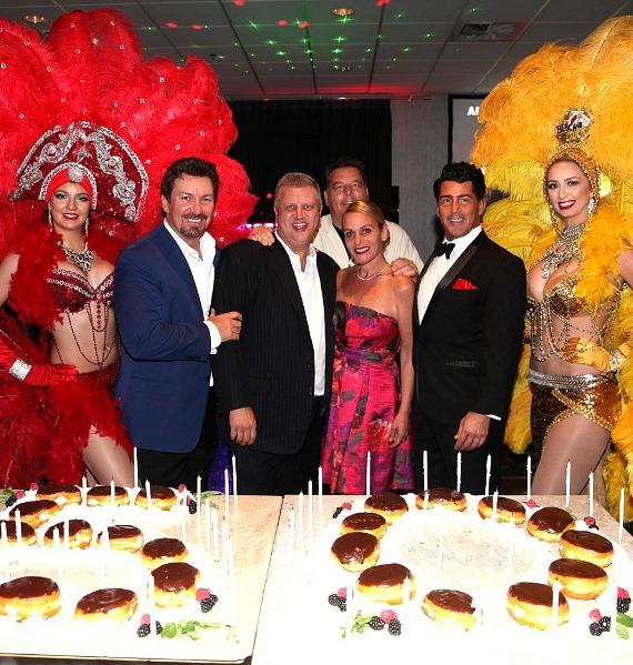 Richard Wilk, CEO Derek Stevens and wife Nicole Parthum, Steven Schirripa (in back) and Drew Anthony with Las Vegas Showgirls at the D Casino Hotel