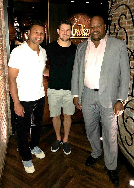 Detroit Red Wings players Trevor Daley and Xavier Ouellet with Executive Host Darren Banks at Andiamo Italian Steakhouse in the D Las Vegas
