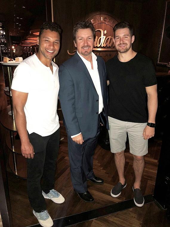 Detroit Red Wings Trevor Daley and Xavier Ouellet with Executive Richard Wilk at Andiamo Italian Steakhouse in the D Las Vegas