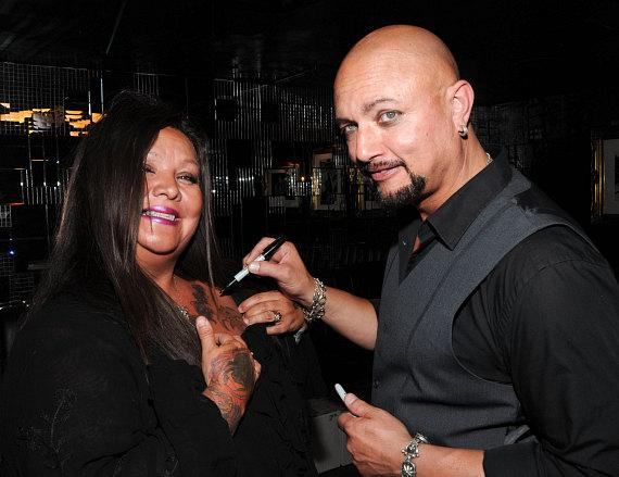 Geoff Tate signs an autograph at Body English at Hard Rock Hotel & Casino