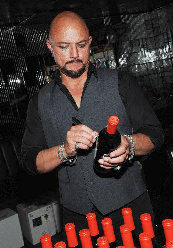 Geoff Tate autographs his signature wines at Body English at Hard Rock Hotel & Casino