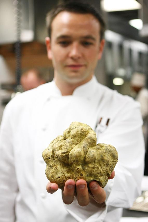 Executive Chef Mathieu Chartron holding the white truffle