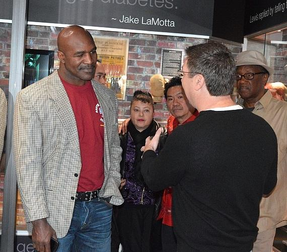 Evander Holyfield talks with fans in SCORE's Boxing Hall of Fame