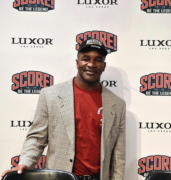 Evander Holyfield on the red carpet at SCORE!