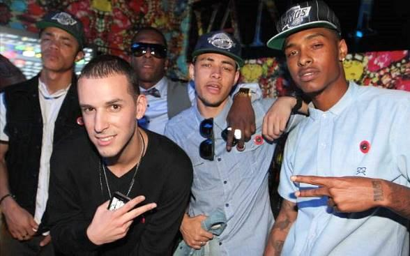 """Dominic """"Legacy"""" Thomas (second from the right)  and Earl """"Ben J"""" Benjamin (far right) of The New Boyz pose with fans at Vanity Nightclub at the Hard Rock Hotel & Casino in Las Vegas"""