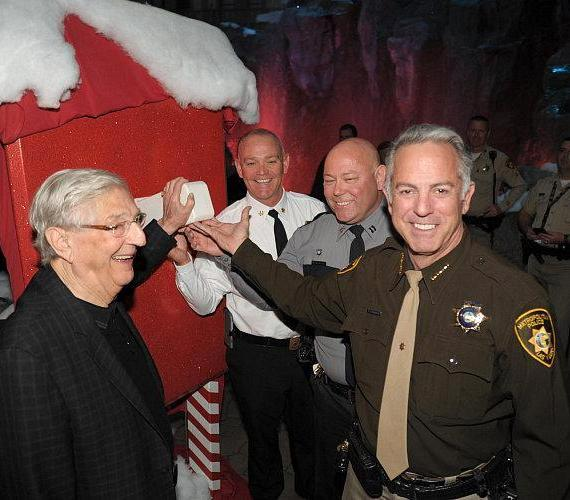 Boyd Gaming Chairman Bill Boyd, Clark County Fire Department Chief Gregory Cassell, Nevada Highway Patrol Captain Charles Haycox and Las Vegas Metropolitan Police Department Sheriff Joe Lombardo flip the switch to kick-off the holiday display at Mystic Falls Park inside Sam's Town