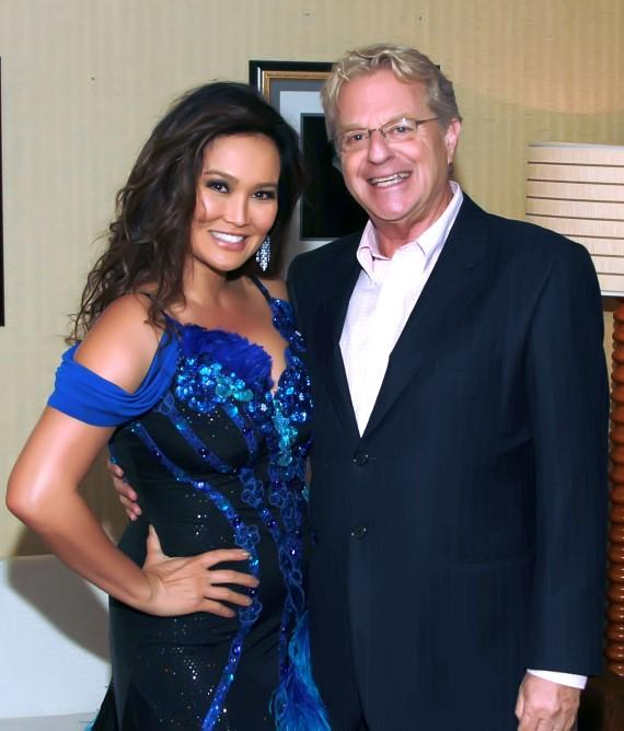 "Tia Carrere and Jerry Springer pose backstage at ""Dancing with the Stars Live in Las Vegas"" inside the New Tropicana"