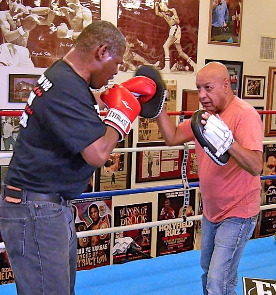 Former Heavyweight Champ Leon Spinks spars with Hall of Fame Referee Joe Cortez