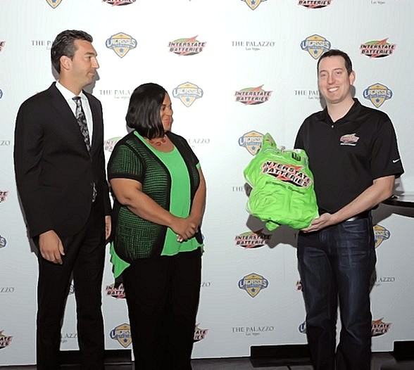 Interstate Batteries and Race Car Driver Kyle Busch Present Lagasse's Stadium with Race-Worn Fire Suit