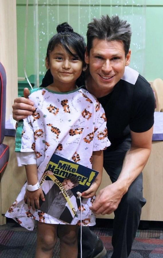 Mike Hammer with patient at UMC Children's Hospital in Las Vegas