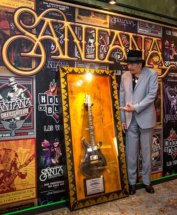 Santana poses with memorabilia display