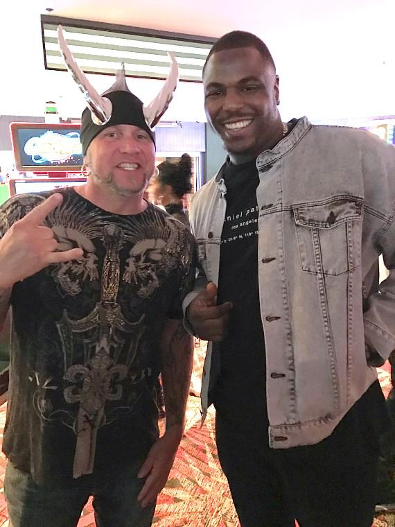 "NFL Malik Jackson (right) with ""Horny Mike"" Henry of ""Counting Cars"" (left) at the LONGBAR in the D Casino Hotel Las Vegas"