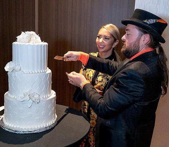 Pawn Stars Chumlee and fiancee Olivia Rademann cutting the Wedding Cake at the D Las Vegas