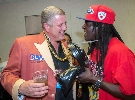 Flavor Flav and the D Casino Hotel Owner Derek Stevens compare clocks
