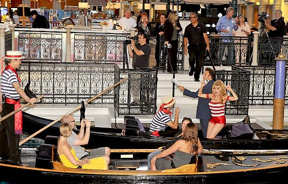 """During rehearsal with co-host entertainer Tony Sacca on the gondola ride at the Venetian's Grand Canal Shoppes, international superstar Charo attracts a crowd and does her """"cuchi-cuchi"""" for passersby."""