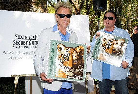 Siegfried & Roy show the new stamp at their Secret Garden at The Mirage