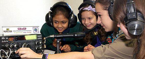 Young girls operating Amateur Radio Equipment