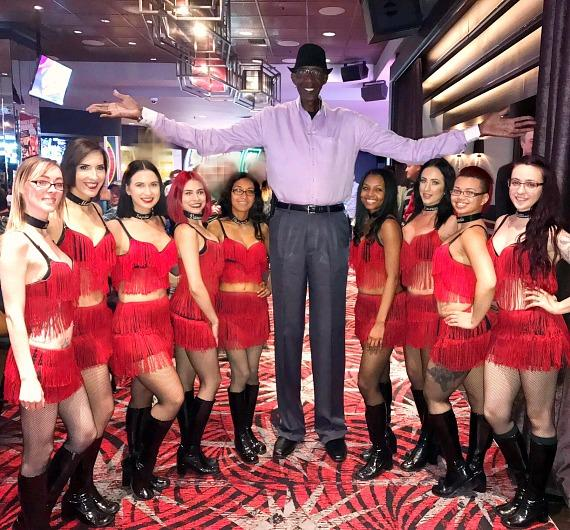 Tallest man George Bell with the Dancing Dealers at The D Casino Hotel in Las Vegas