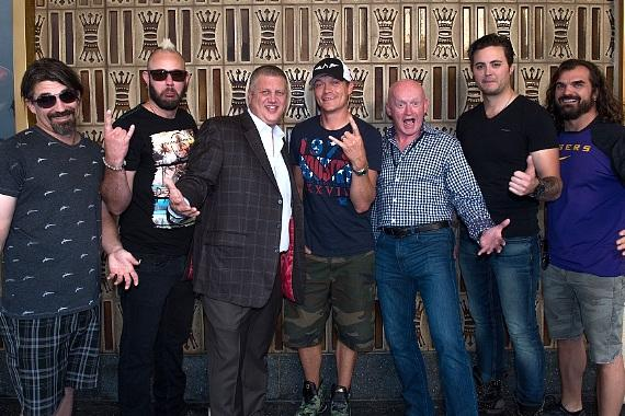the D Owner Derek Stevens with Fremont Street President Patrick Hughes and band 3 Doors Down