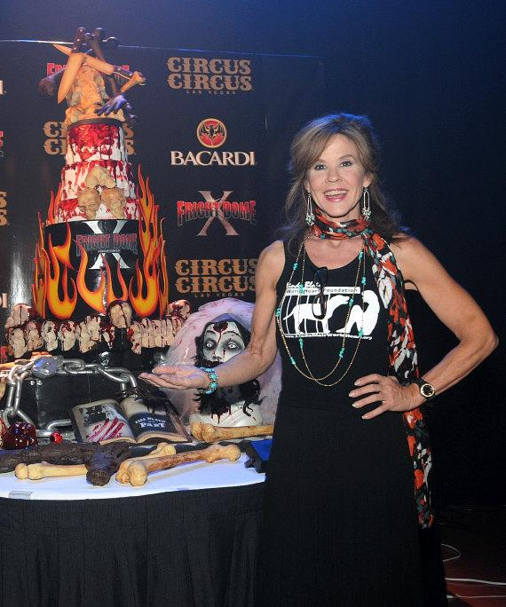 Linda Blair poses with 10th Anniversary cake