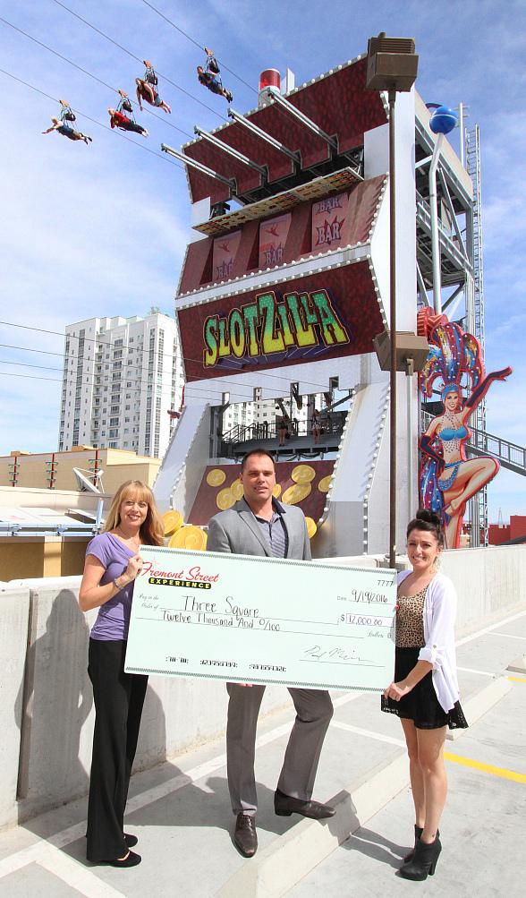 Fremont Street Experience Presents Three Square Food Bank a Check for $12,000 Raised from SlotZilla Charity Challenge