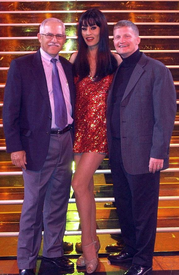 Tropicana Vice President of Marketing Randy Sears, Folies Bergere Showgirl Janu Tornell and Nellis Air Force Base Colonel, USAF Commander Howard D. Belote pose in front of the infamous golden staircase.