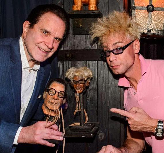 Rich Little and Murray Sawchuck pose with their shrunken heads at The Golden Tiki