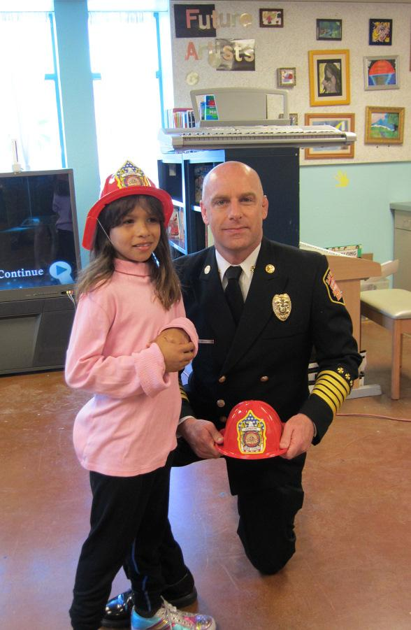 Meredith Rodriguez poses with Mike Myers, chief of Las Vegas Fire & Rescue
