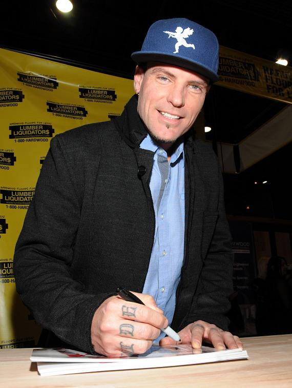 Vanilla Ice signs auitographs in Lumber Liquidators Booth at 2013 Int'l Builders' Show