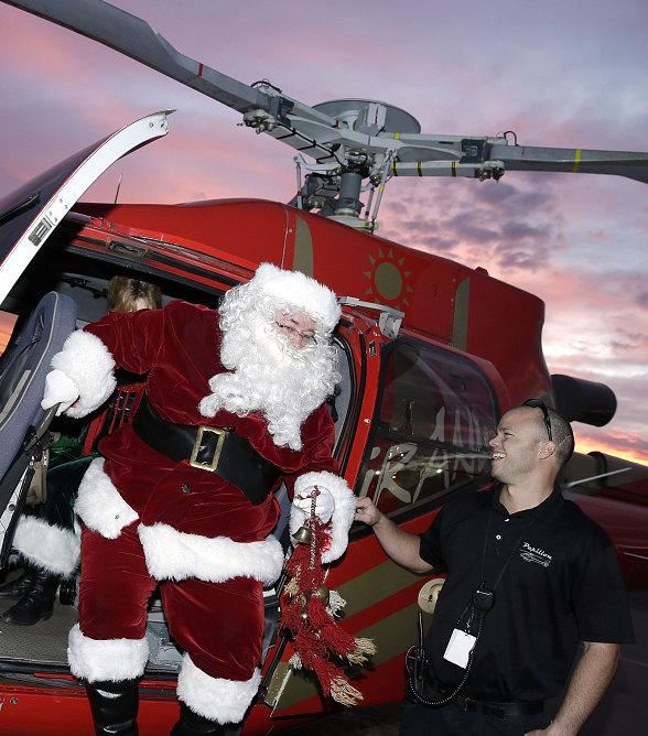 Mr. and Mrs. Santa Claus Deliver Gifts to Nearly 60 St. Jude's Ranch Children via Helicopter