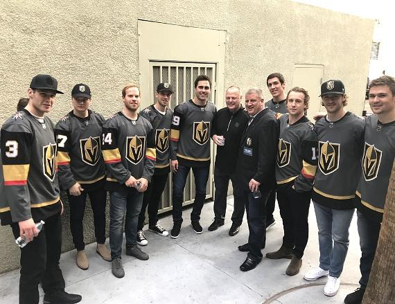 Vegas Golden Knights posing with Casino Owner Derek Stevens Backstage