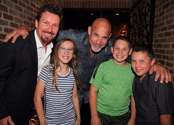 WWE Legend Goldberg posing with son, Gage Goldberg, and the Wilk Kids